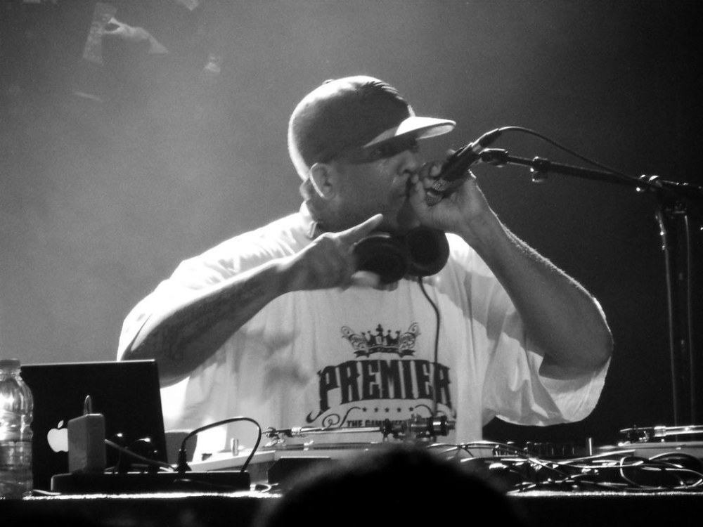 Hip-hop musician DJ Premier mixing records on turntables